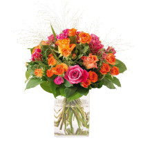 round bouquet of fuchsia and orange roses