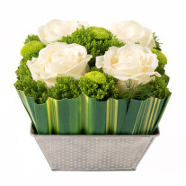 arrangement of 4 white roses and greenery